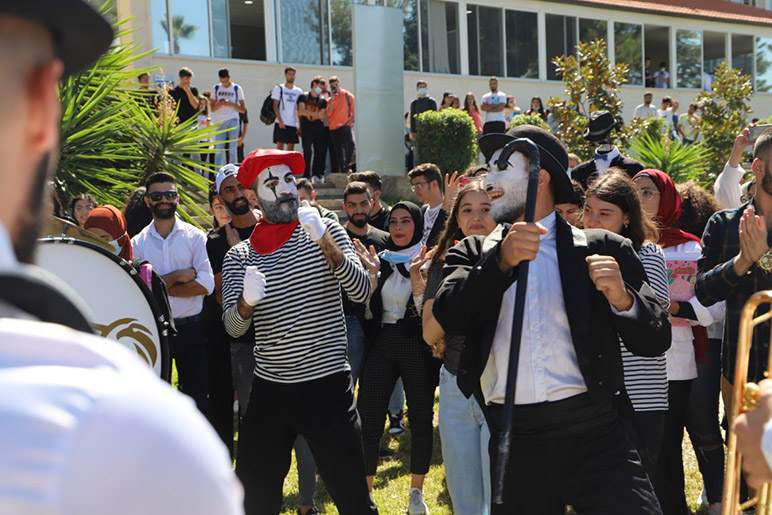 A black-and-white-themed party welcomes students back home to RHU
